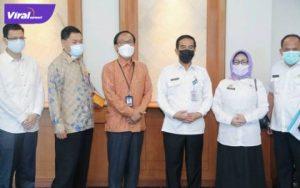 Plh Sekda Sumsel, Akhmad Najib saat menghadiri Focus Group Discussion (FGD) Monitoring Implementasi QRIS. Foto : viralsumsel.com /sep